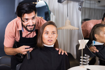 Man specialist with female talking about hairstyle