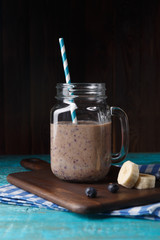 Picture of jug with milkshake with straw