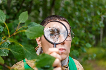 Image of botanist man with magnifying glass