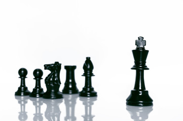 Black Chess on white background . Leader and teamwork concept for success.