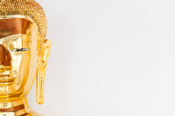 half of a buddha's face on white background