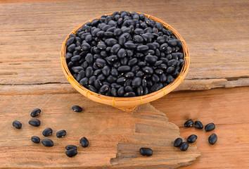 Black bean on wooden floor