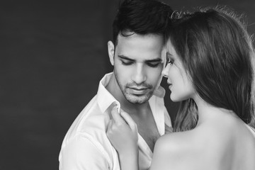 Fashion portrait of a beautiful sexy couple. Black and white image