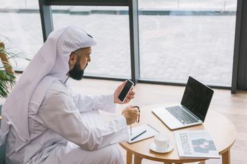 muslim businessman using smartphone