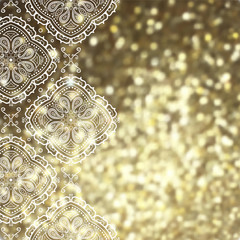 Golden glitter background with white lace