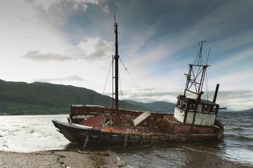 UK, ship wreck at seafront