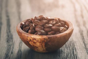 freshly roasted arabica coffee beans in bowl