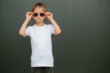 Girl kid wearing white blank  t-shirt with space for your logo or design in casual urban style
