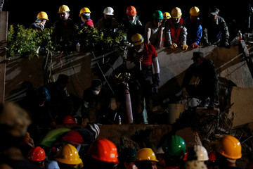 Rescue workers search for students at Enrique Rebsamen school in Mexico City