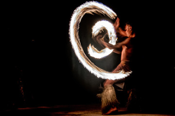 Fire dance Cook Islands polynesian dancer with pole of flames