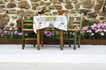 chairs and table set on stone wall