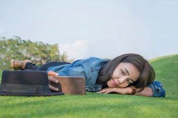 Women lying down selfie on the grass