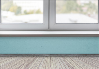 Pine floor and part of the clean white window and sill in a room