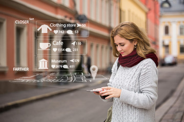 Augmented reality in marketing. Woman traveler with phone. Navigation on the projection of the display