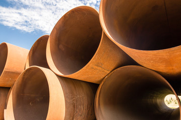 large rusty metal pipes as a background
