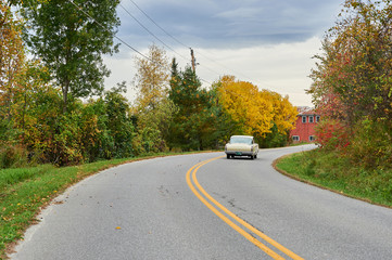 Old car on road in autumn