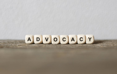 Word ADVOCACY made with wood building blocks