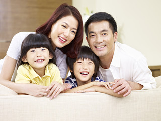 portrait of an asian family with two children.