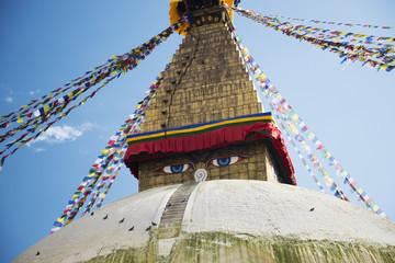 Prayer flags Buddhist stupa illuminated panorama at Boudhanath Kathmandu Nepal