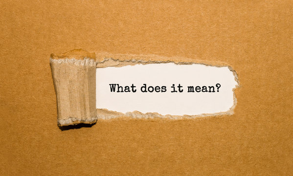 The text What does it mean appearing behind torn brown paper