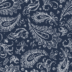Vintage paisley ornament - seamless pattern. Grunge texture. White flowers, leaves and curls on a blue background. Handmade. Prints for textiles. Bohemian motives.
