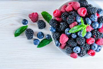 Various fresh summer berries,blueberries, raspberries and black berries shot from above