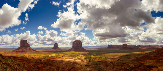 View of Valley of the Gods against cloudy sky