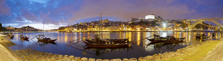Panoramic view of boats moored in Douro River against Dom Luis I Bridge