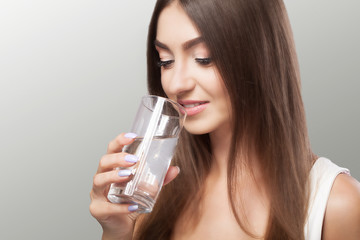 Healthy Lifestyle. Portrait Of Happy Smiling Young Woman With Glass Of Fresh Water. Healthcare. Drinks. Health, Beauty, Diet Concept. Healthy Eating.
