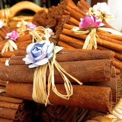 cinnamon sticks tied with bow in basket