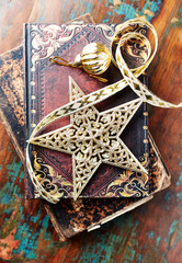 Old style Christmas Star on books