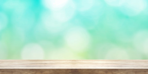 Empty wooden table top front of blurred summer abstract background. Panoramic banner.