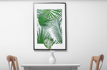Framed picture of tropical foliage and monstera leaf in dining room