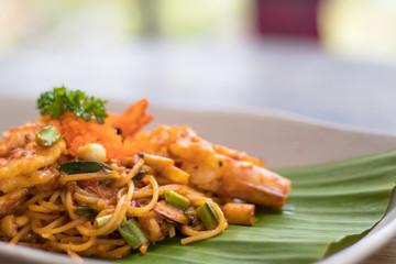 Spaghetti fried with sour prawn soup