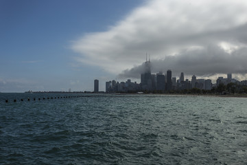 Chicago skyline with lake and clouds