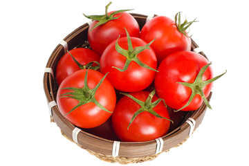 Small basket full of red tomatoes