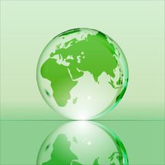 Green shining transparent earth globe with Eurasia, Africa and Australia continents laying on glass surface and reflecting in it. Bright and shining design. Vector illustration.