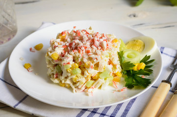 Crab stick salad features rice corn eggs and cucumber