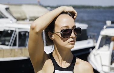 Young woman enjoying a summer trip on a sailboat