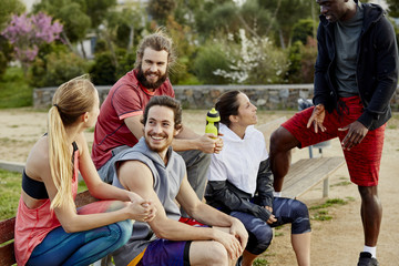 Athletes Relaxing After Workout In Park