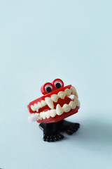 Close up of marching vampire's denture toy with googly eyes