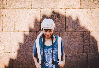 Asian traveller at Banteay Srei temple in Siem Reap (Cambodia)
