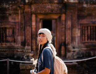 Female traveller at Banteay Srei temple in Siem Reap (Cambodia)