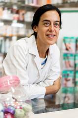 Woman pharmacist over drugstore background