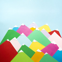 Several colorful mountains made of paper
