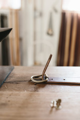 leather belt being made on table in studio