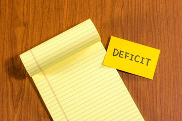 Deficit; White Blank Documents with Small Message Card.