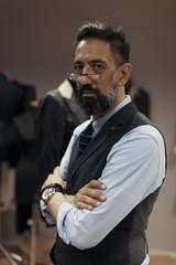 Portrait of a man fashion designer in atelier
