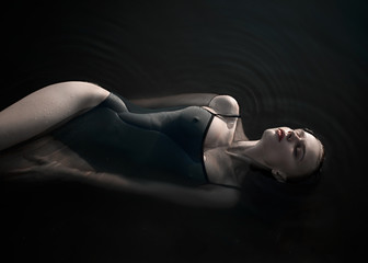 Portrait of woman floating on water