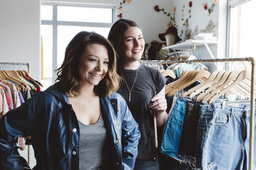 Young entrepreneur helping customer in pop up shop